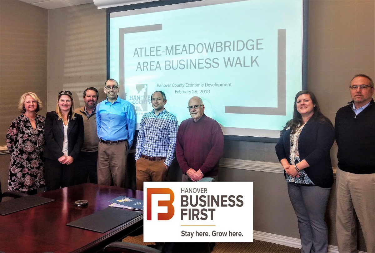 People gathered in a board room for the Atlee-Meadowbridge for the first Business Walk of 2019
